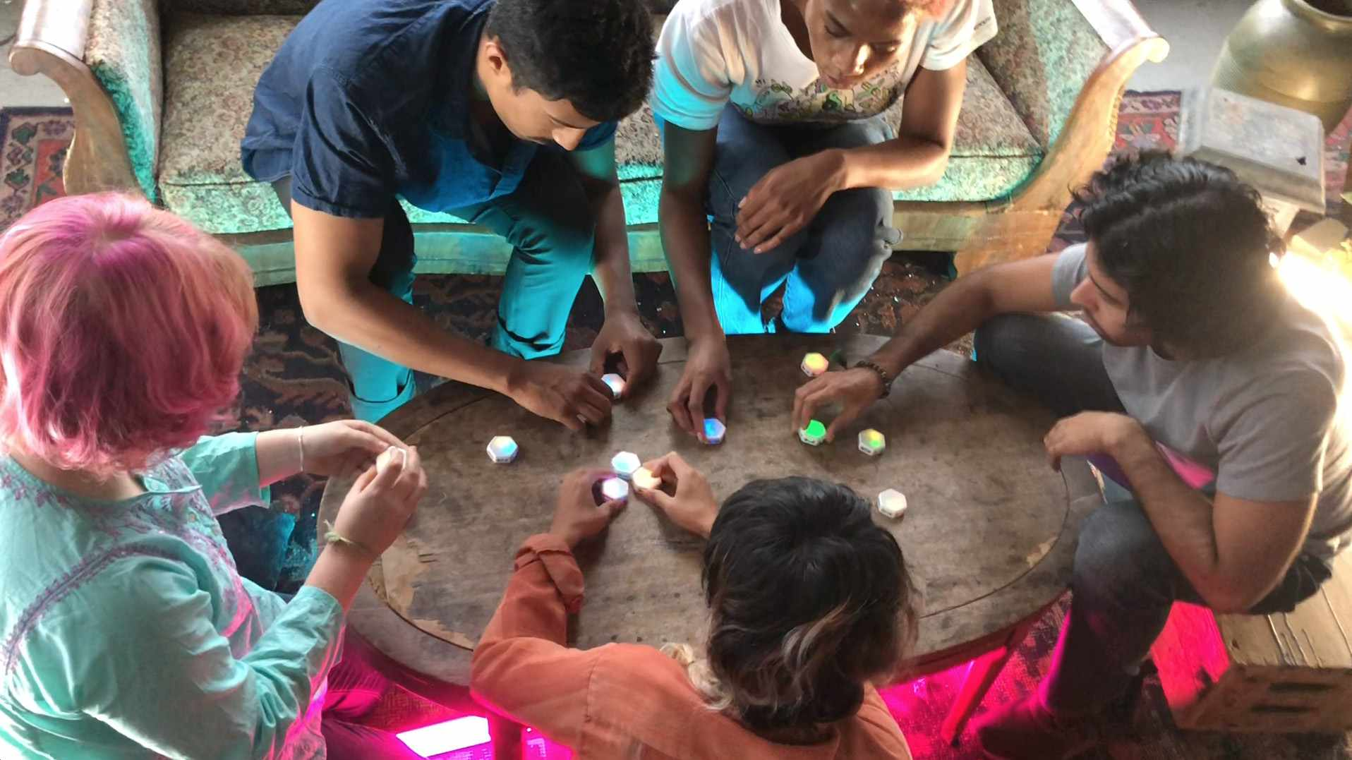 A group of people play the Blinks game.
