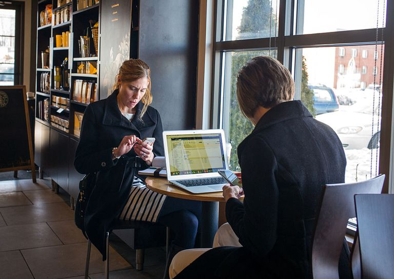People checking email at a coffee shop