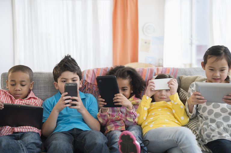 Picture of children reading ebooks on their devices