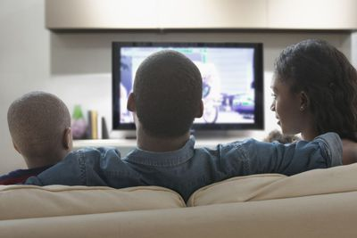 Image of a family watching TV