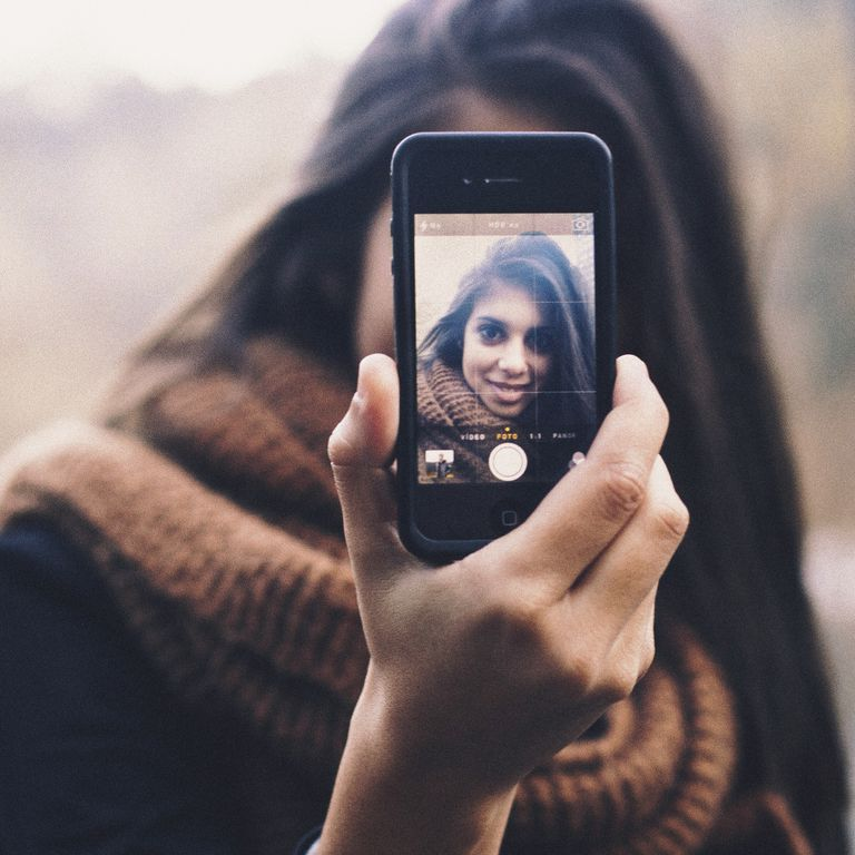 Woman taking a selfie on a Smartphone camera