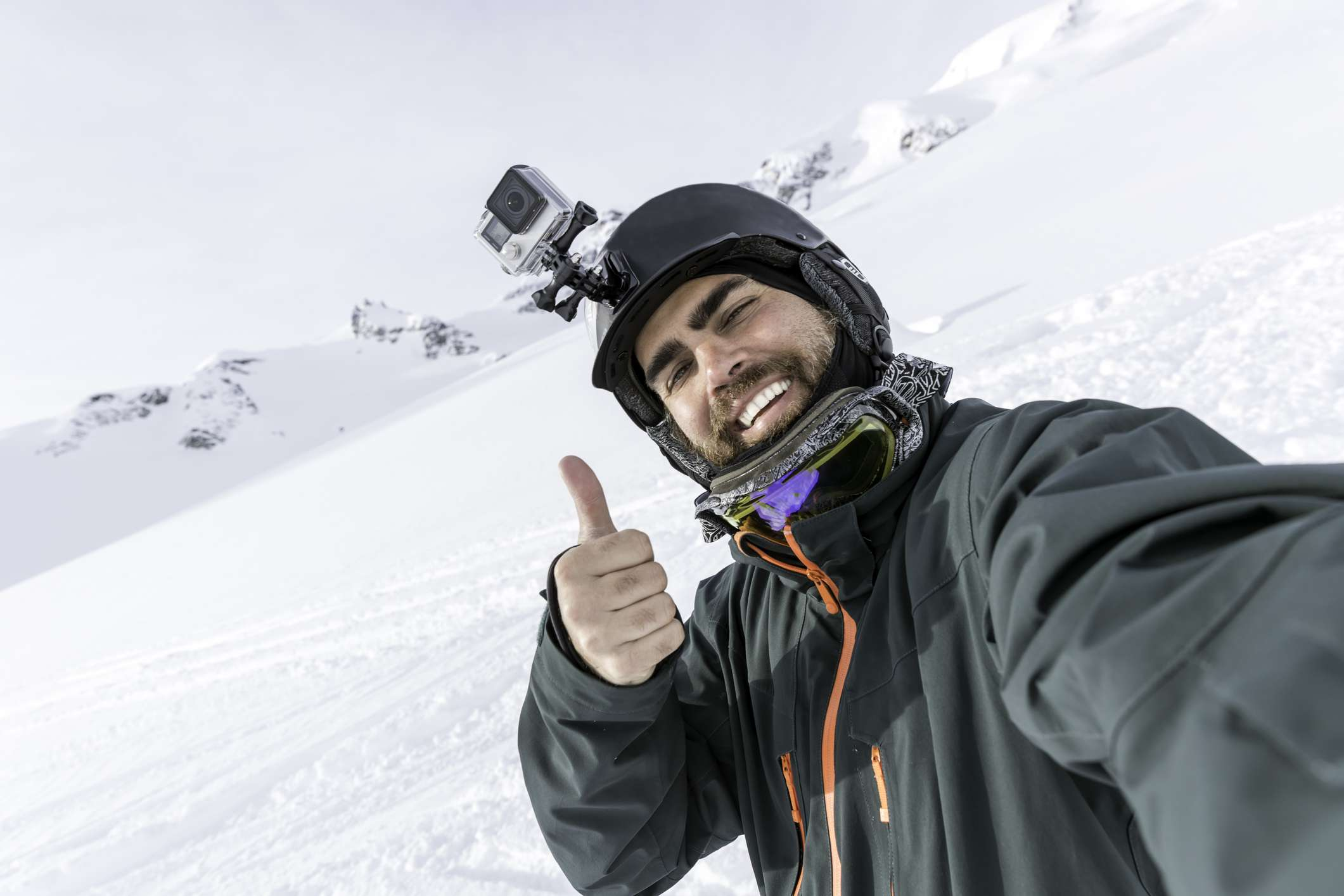 Skier with GoPro in the mountains
