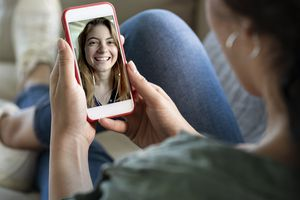 An image of two women having a video call on their smartphones.