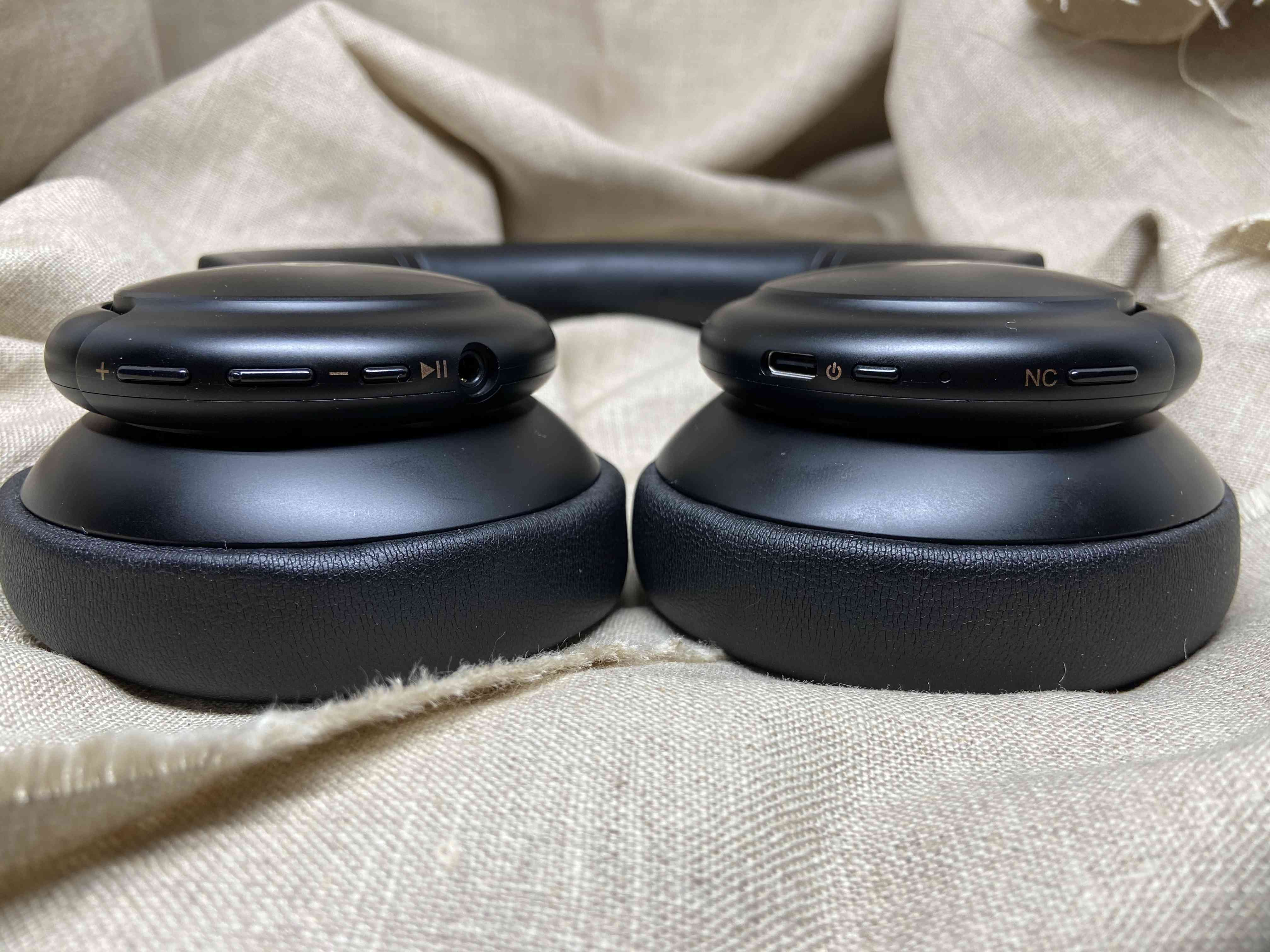 The Soundcore Life Q30 headphones laying down and showing their various buttons