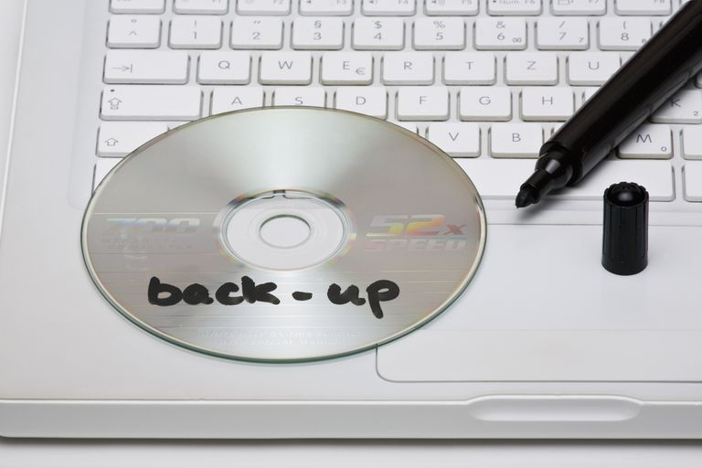 Detail of a back-up disc and a marker on a laptop