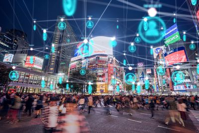 Photo of Hachiko Crossing in Shibuya, Tokyo, Japan with digital network blue light rendered on top.