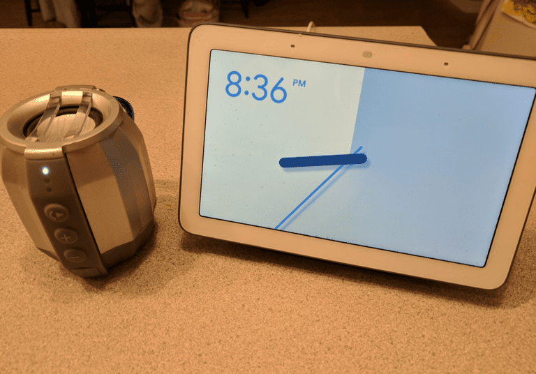 An image of a Google Home hub and a bluetooth speaker