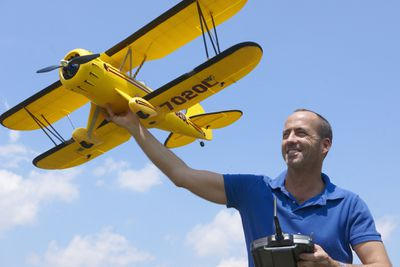 Man launching remote control airplane