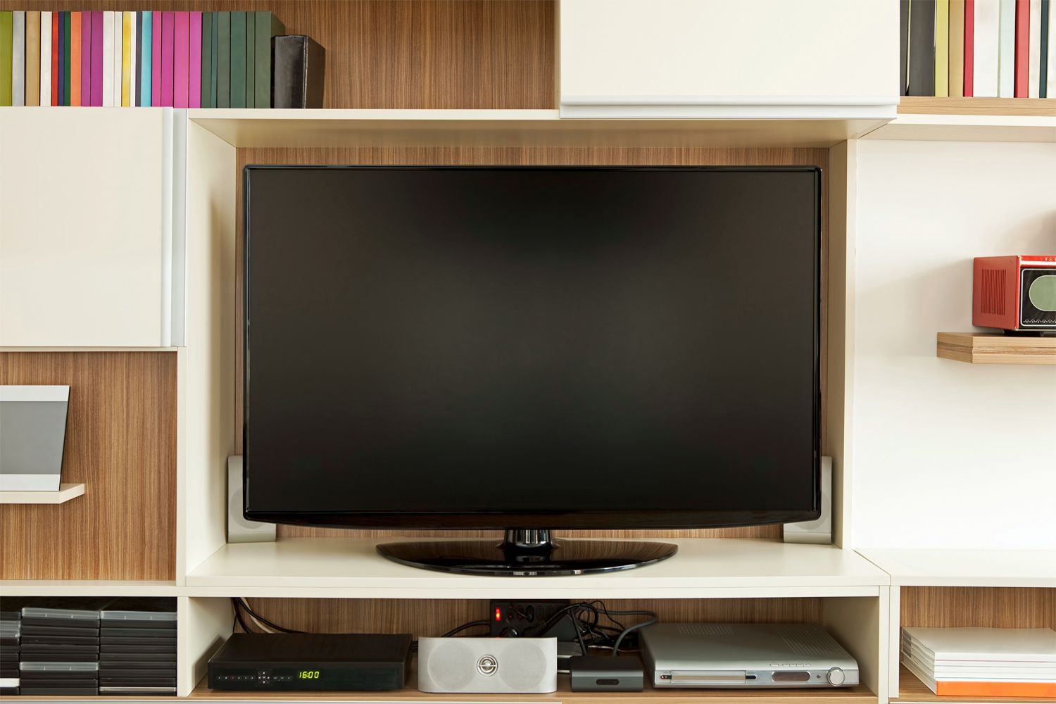 An LCD TV set in a wall unit