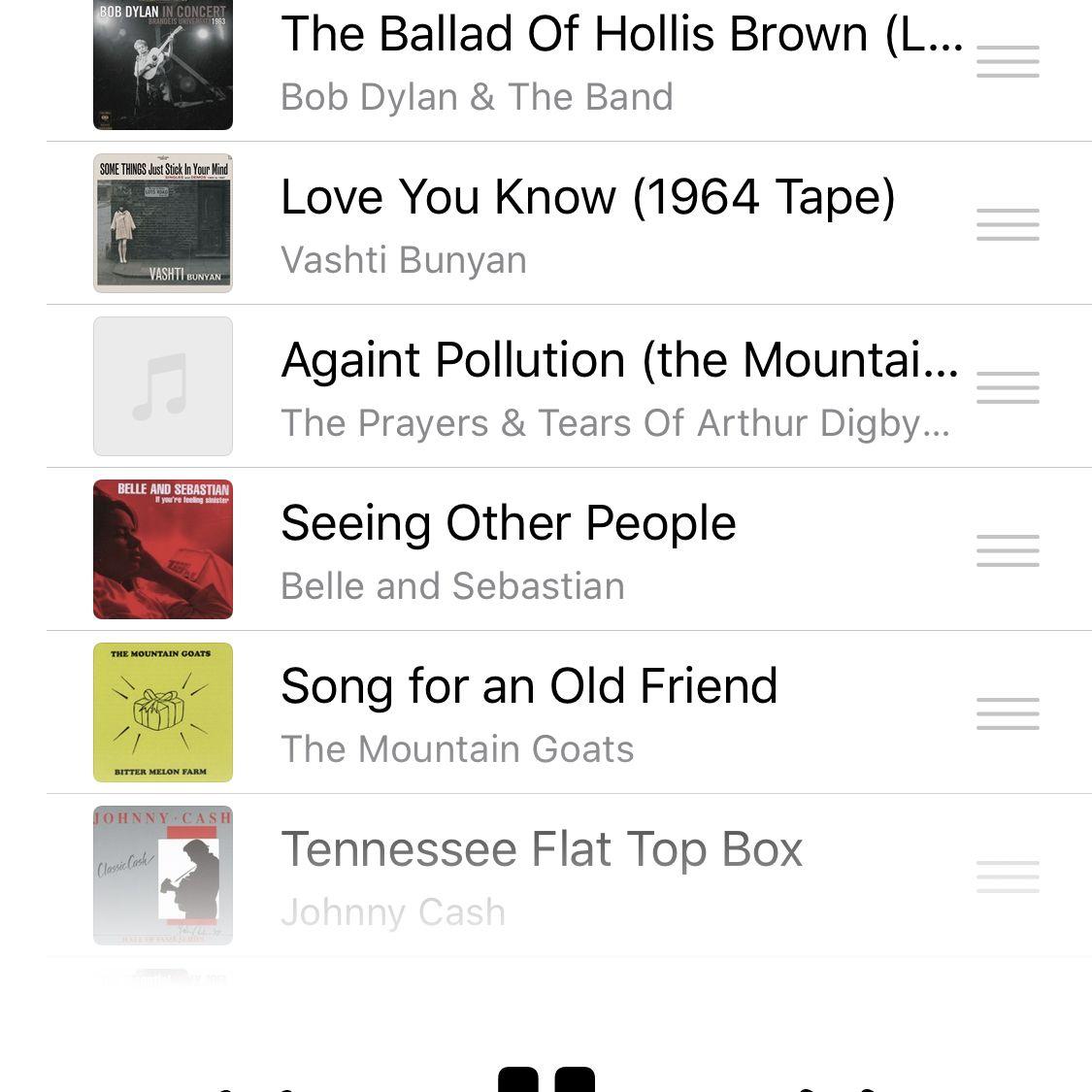 Screenshot of iOS Music app showing Up Next