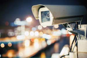 Security camera, city lights background