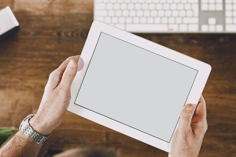 Image Of Hand Using Digital Tablet At Desk
