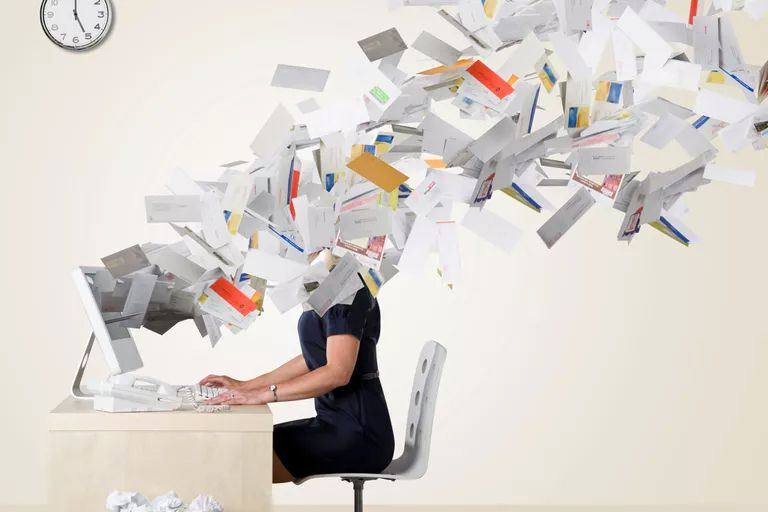 Woman overwhelmed with mail flying from computer