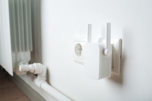 Wi-Fi extender plugged into a wall outlet.